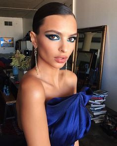 Pin for Later: Photos Won't Do Emily Ratajkowski's Emmys Gown Justice — You Need to See It in Action Emily Paired the Look With Drop Earrings