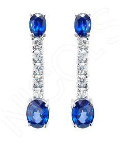 Pendientes NICOL´S. Pendientes largos con zafiros ovales en garras y línea de diamantes talla brillante engastados en garras, cierre con pincho y presión mariposa. Fabricados en oro blanco 18kt, Z 7.13qt y D 1.33qt.