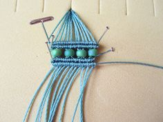 Straight pins and t-pins used to hold micro macrame by Sherri Stokey
