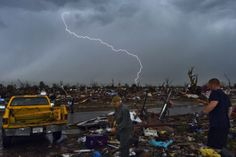 JEWEL SAMAD/AFP/Getty Images Lightning strikes during a thunder storm as tornado survivors search for salvageable items at their devastated home on May in Moore, Okla. Tornados, Thunderstorms, Natural Phenomena, Natural Disasters, Oklahoma Tornado, Oklahoma City, Tornado Season, Fuerza Natural, Tornado Damage
