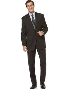 The trousers are slimmer, slightly shorter with a traditionally fitted jacket.  Calvin Klein Suit, Black Solid Slim Fit - Mens Suits & Suit Separates - Macy's