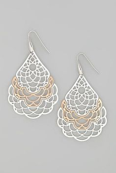 Sterling silver and rose gold dream catcher drop earrings.