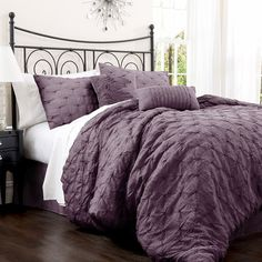 4-piece cotton-blend comforter set with embroidered detail.   Product: Queen: Comforter, bedskirt and 2 standard shams