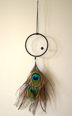 Hey, I found this really awesome Etsy listing at http://www.etsy.com/listing/162777230/brown-peacock-feather-dream-catcher-with