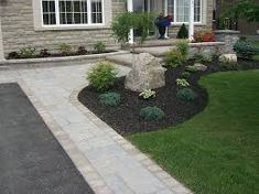 Asphalt Driveway with Interlock Border. Plant the Tree in place of rock. i like the steps. Up to the porch
