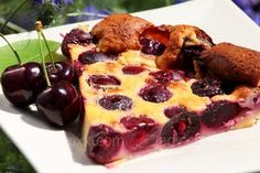 Preparation: Mix the flour, sweetener, eggs, pour milk. Ingredients mix until smooth, add milk. Let the dough stand for 10 minutes. Silicone, glass moulds, or grease the baking sheet with butter, sprinkle with flour. On the bottom put sliced fruit or berries(we have cherry), pour the batter.