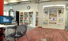Wall held display unit with inset lighting at the Woolwich Centre Library.