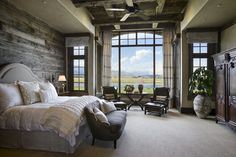 Love this bedroom by Locati Architects! The mix of barnboard, antiques and the white upholstered headboard is stunning.