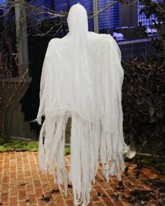 Cheesecloth Ghosts  Hang these easy-to-make cheesecloth ghosts from tree branches and porch railings to create a haunting Halloween scene.