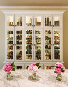 Lighted Shoe Wardrobe - Great idea for walk-in closet. Could use Ikea cabinets with glass shelves.
