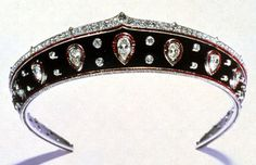 A kokoshnik-shaped gemset platinum-mounted blackened steel tiara, the metal band bordered with calibré-cut rubies, with a band of old-mine diamonds above and rose-cut diamonds below, set with thirteen pear-shaped diamonds within calibré-cut ruby-set frames alternating with pairs of collet-set circular-cut diamonds - workshop: Picq, stamped HP, Paris 1914, Provenance: Queen Marie of Roumania