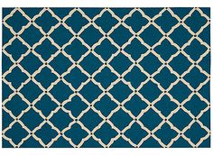 "This 8' x 10'6"" Portico outdoor rug features a classic latticework pattern that offers purity of design and traditional sophistication in an elegant broadloom. The open work grid in a neutral tone accentuates the richly pigmented colors of this attractive and versatile rug. The densely tufted pile has UV protection that locks in the color, making it an ideal choice for easy living and lasting beauty. This vivid navy and cream latticework pattern will assuredly add an exciting dash of…"