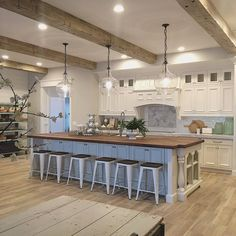 Give me wide open spaces with this clean, retro-inspired farmhouse kitchen. Great for entertaining and a nice fit to an open modern farmhouse floor plan.