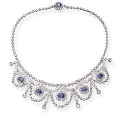 A SAPPHIRE AND DIAMOND NECKLACE   The front suspending five oval-cut sapphires surrounded by rose-cut diamonds, enhanced by a series of rose-cut diamond swags and rose-cut diamond drops, joined by a rose-cut diamond backchain to a sapphire and diamond clasp of similar design, mounted in 18K white gold, 16¼ ins.  The total weight of the sapphires and diamonds is approximately 14.50 and 19.50 carats