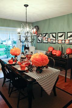 A decorated dining room for Halloween with table arrangement