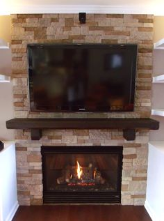 Stone work hearth and custom harvested cantilever beam supported mantle.