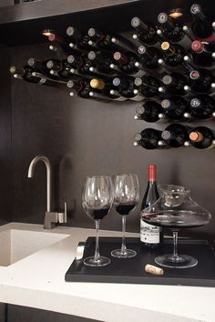 wall mounted wine storage idea stainless steel pegs contemporary kitchen