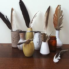 feathers coming out of bottles