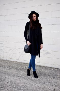 Long Knit Vest, Black Mockneck Sweater, Black Wool Fedora, Black Crossbody, Old Navy Skinny Jeans, and Black Booties Winter Outfit