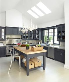 I didn't think I would like dark colors in the kitchen bit I like this.  Not too crazy about the lights - maybe replace it with a hanging pot rack?