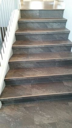 Luxury vinyl tile installed with custom insert stair nosings. Tiled Staircase, Tile Stairs, Flooring For Stairs, Concrete Stairs, Staircase Remodel, Staircase Design, Modern Staircase, Carpet Stairs, Redo Stairs