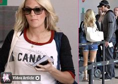 Carrie Underwood leaving Toronto w/Mike Fisher (and sporting a Canada tee!)