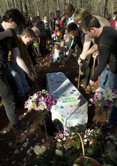 """Friends and family gather to celebrate a friend's life at a """"green"""" burial site where no chemicals are used and everything is biodegradable, including the casket which was made out of cardboard."""