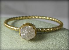 Raw diamond solitaire in a cabled gold setting from Earth Diamond on Etsy.