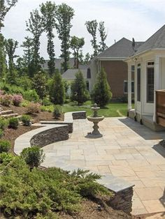 Small Patio Designs by Stone Retaining Wall and Terrace Garden