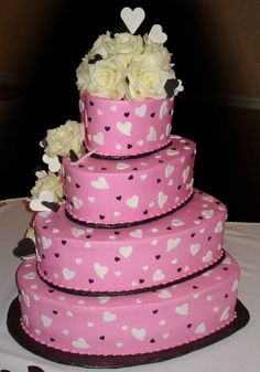 Pink buttercream iced with Black and pink fondant and gumpaste hearts and fresh flowers