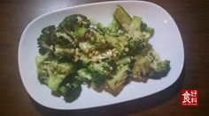 Charred Broccoli with Smoked Oyster Aioli, Pickled Garlic and Pine Nuts.