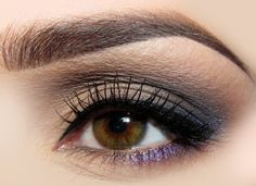 Love the shimmery lavendar shadow used as eyeliner.  And the brows are sheer perfection!