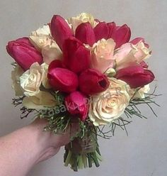 Bouquet for Lithuanian - Chinese weddings. Red tulips and cream roses with bilberry branches.