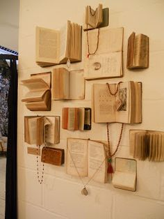 A wall of open books make an interesting prop for #jewelrydisplay