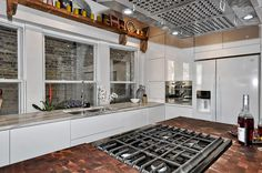 4502 N Magnolia Unit 1N Sheridan Park - Uptown - Chicago, Illinois - Christian Schaller, Johnson Roberts Associates Architects Inc. 2015 For sale @ $485,000  Kitchen: Black Walnut Butcher block Waterfall edge from John Boos Effingham, IL, reclaimed Barnwood Walls, Hickory Flooring. Ikea White Cabinets, Ben Moore newburyport blue HC 155 Ceilings, Pure White walls and trim. Reclaimed Barnwood Shelving, Danby Vermont White Marble Counters.
