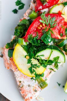 Mediterranean-style Oven Baked Salmon in Foil   The Mediterranean Dish. Salmon with garlic and thyme, topped with vegetables and a buttery-lime sauce and baked in foil to perfection!  Bakes in less than 25 mins! Try this easy dinner soon.