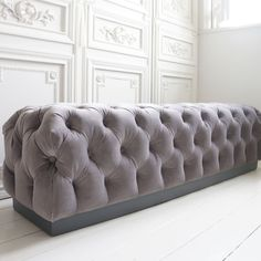 Velvet Chesterfield Bench by the French Bedroom Company. Upholstered in a soft grey velvet with deep buttoning, this bedroom ottoman is the epitome of luxury.