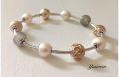 Pearls, gold and grey moonstone Essence. :)