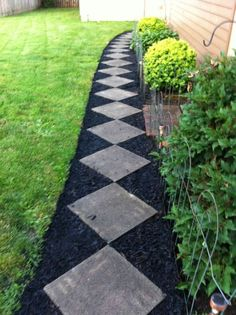 black mulch landscaping ideas   ... for an inexpensive walk with a curve. Finish off with black mulch #landscapingideas
