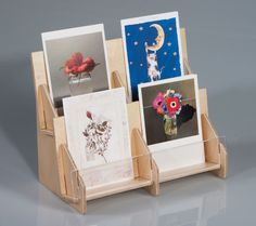 Elegant, affordable tiered countertop card rack.  Perfect for greeting cards, postcards and DVDs.  Made in the US from susyainable birch plywood and ready to ship