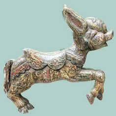 """Mexican - $1250  Mexican Carousel Figure of a Donkey or Burro, last half of 20th C. Highly stylized figure of a happy donkey or burro.  Purchased in Southern California in the 1960's. Carved wood, plaster, and composite, old paint and old repairs. 39"""" long."""