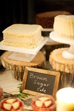 I like the wood cake stands and the simple chalk boards. Maybe those could be your table numbers, too.