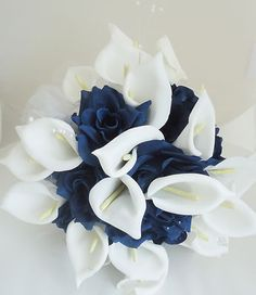 Fake flowers wedding bouquet, but more blue less white