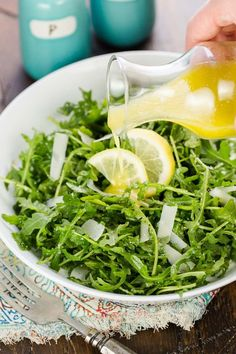 This simple 5 ingredient Arugula Salad with Lemon Vinaigrette always disappears. The peppery arugula is the perfect partner to the tart lemon dressing!