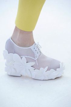 Delpozo. Walking barefoot through a bed of flowers.