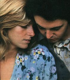 Paul and Linda McCartney. these 2 had a lovely wonderful life. music and their kids very wonderful