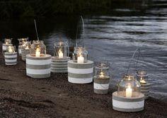 beach inspired garden decor - glass hurricanes