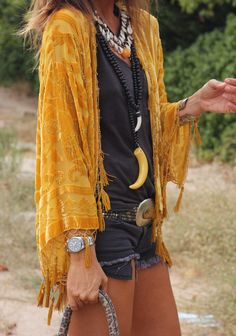 velvet fringe jacket with modern hippie necklaces and chunky silver belt buckle..