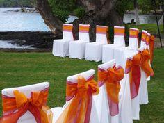 Wedding Chair Covers $1. White Covers, Orange and Fuchsia Sashes. Bellingham WA