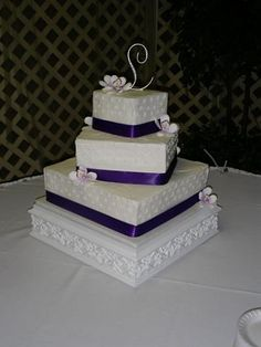 Offset Tiers With Purple Ribbon Wedding Cake By Pm Frosted Www Pmcakes